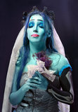 Corpse bride under blue moon light. Halloween: Sorrow scene of a corpse bride under blue moon light royalty free stock photos