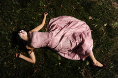 Corpse in the forest. Pretty teen alone in the forest, may be use for sad, halloween or dead concept Stock Photos