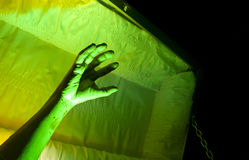 Corpse Hand Reaching. Scary Zombie Hand Reaching Up from out of a casket coffin Stock Photo