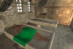 Corpse in morgue. A desiccated corpse lies on marble slab in mortuary Stock Photos
