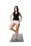 Corpulent woman training yoga Royalty Free Stock Images