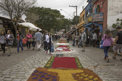 Corpus Christi carpets enchant believers and tourists in Embu da stock photography