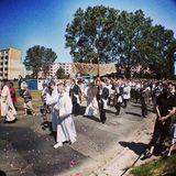 Corpus Christi Day. Crowd people during procession. Artistic look in vintage vivid colours. Royalty Free Stock Photo