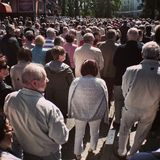 Corpus Christi Day. Crowd people during procession. Artistic look in vintage vivid colours. Royalty Free Stock Photography