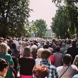 Corpus Christi Day. Crowd people during procession. Artistic look in vintage vivid colours. Stock Images