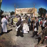 Corpus Christi Day. Crowd people during procession. Artistic look in vintage vivid colours. Stock Photos