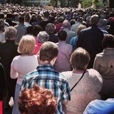 Corpus Christi Day. Crowd people during procession. Artistic look in vintage vivid colours. Royalty Free Stock Images
