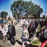 Corpus Christi Day. Crowd people during procession. Artistic look in vintage vivid colours. Stock Photo