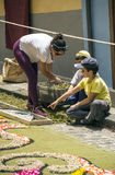 Corpus Cristi in La Orotava. People working in the streets of the Orotava on the day of the carpets of flowers in the Corpus Cristi. It is an editorial image stock photos