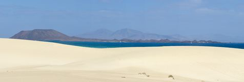 Corrajelo on Fuerteventura. Atlantic cean and sand dunes Corralejo on Fuerteventura. Panorama Stock Images