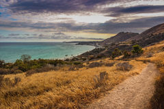 Corral Canyon Malibu Trail. Dramatic clouds and coastline view of the Pacific Ocean from the Corral Canyon trail in Malibu, California Royalty Free Stock Photos