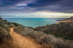 Corral Canyon Malibu Trail. Dramatic clouds and coastline view of the Pacific Ocean from the Corral Canyon trail in Malibu, California Royalty Free Stock Image