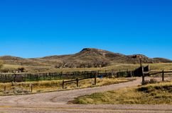 The Corral. This is a landscape photo of a corral in the forefront and a mountain behind Royalty Free Stock Photo