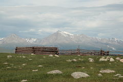 A corral and mountain peak Munch-Sardyk - 3491 meters above sea level. Mountain landscape in July from Mongolia – in the background the highest mountain in the Stock Photo