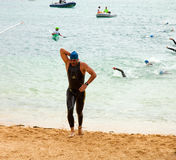 CORRALEJO - April 07: Men finish  the swimming part of the race Royalty Free Stock Photos