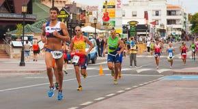 CORRALEJO - April 07: Participant at the running part of the race of Fuerteventura triathlon 07 April, 2013 in. Corralejo, Fuerteventura, Spain royalty free stock photos