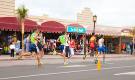 CORRALEJO - April 07: Participant at the running part of the race of Fuerteventura triathlon 07 April, 2013 in. Corralejo, Fuerteventura, Spain royalty free stock image