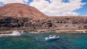 Tourists visit the coast of fuerteventura with taxi service royalty free stock photos