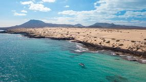 Tourists visit the coast of fuerteventura with taxi service royalty free stock image