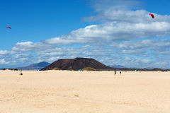 Corralejo sand dunes and extinct volcanoes including montana Roja in the background. Fuerteventura Royalty Free Stock Images