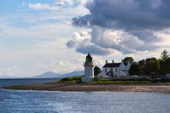 Corran lighthouse under dramatic sky, near Fort William, in Highlands stock image