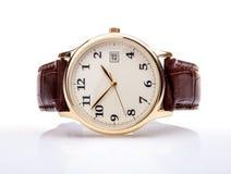 Correa de cuero del reloj de oro Imagen de archivo libre de regalías