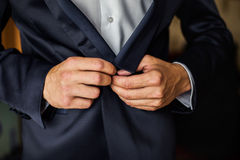 Correct button on jacket, hands close-up, dressing, man's style, Royalty Free Stock Image