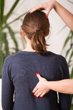 Correct posture. Therapist setting young women in correct posture royalty free stock images