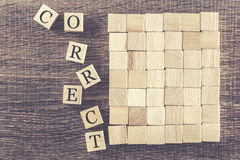 Correct word formed with wooden blocks Stock Image