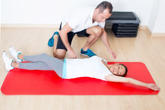Correcting a stretching exercise Royalty Free Stock Photos