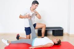 Correcting a stretching exercise Stock Image