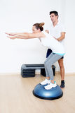 Correcting a stretching exercise Royalty Free Stock Images
