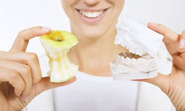 Correction of bite (denture model). Woman holding a teeth sample and apple Stock Photography