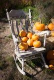 Correction de potiron et chaise de basculage Photographie stock libre de droits