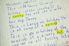 Correction of error in English handwritten text, words marked with yellow color Stock Photography