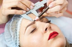 Correction of eyebrows. In the beauty salon Stock Photo