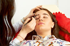 Correction of eyebrows in a beauty salon Royalty Free Stock Images
