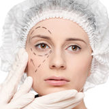 Correction lines on woman face Stock Image