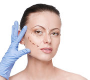 Correction lines on woman face Royalty Free Stock Images
