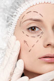 Correction lines on woman face operetion Royalty Free Stock Photo