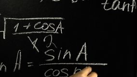 Correction of mistakes in the written formula. On the blackboard with chalk stock footage