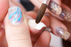 Correction of nails using acrylic. French manicure royalty free stock photo