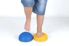 Corrective exercises for children with flat feet. On white background stock image