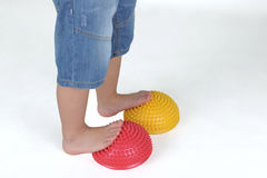 Corrective exercises for children with flat feet. On white background royalty free stock images