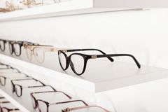 Corrective eye glasses. Close up picture of corrective eye glasses in an optics store stock photos