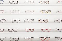 Corrective eye glasses. Picture of corrective eye glasses in an optics store royalty free stock photography