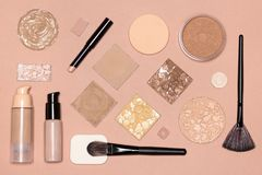Corrective makeup flat lay set on nude color surface royalty free stock image