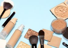 Corrective makeup products and make-up brushes with copy space stock photography