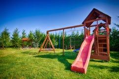 Corrediça e balanços de Childs imagem de stock royalty free