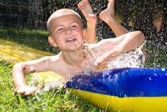 Corrediça e miúdo de água Imagem de Stock
